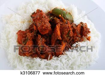 Picture - chicken tikka masala closeup. fotosearch - search stock photos, pictures, wall murals, images, and photo clipart