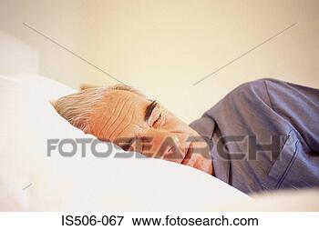 Foto - homem, dormir.  fotosearch - busca  de fotos, imagens  e clipart