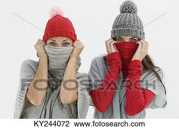 Banco de Imagem - retrato, dois,  mulheres, escondendo,  seu, caras. fotosearch  - busca de fotos,  imagens e clipart