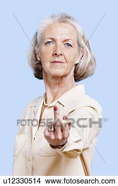 Banco de Imagem - sênior, mulher,<br /> casuals, fazer.<br /> fotosearch - busca<br /> de fotos, imagens<br /> e clipart