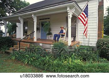 Stock Photo - old man sitting  on the porch.  fotosearch - search  stock photos,  pictures, wall  murals, images,  and photo clipart